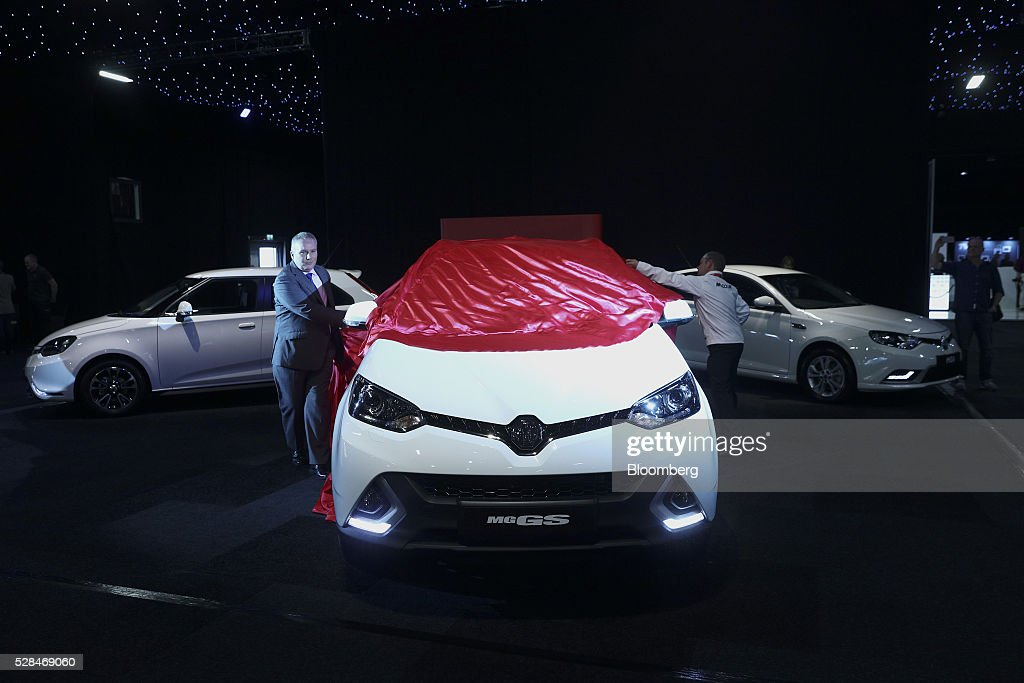 Matthew Cheyne, head of sales and marketing unveils a MG GS, a sports utility vehicle (SUV), manufactured by MG Motor UK Ltd. at the London Motor Show in London, U.K., on Thursday, May 5, 2016. MG Motor UK Ltd. manufactures convertible sport coupes with various options, features, and accessories to choose from. Photographer: Simon Dawson/Bloomberg via Getty Images