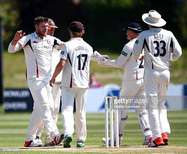 Matthew Coles of Kent celebrates after taking the wicket of Surrey's Kumar Sangakkara during day four of the LV County Championship match between...