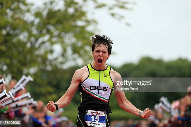 Matthew Collyer of Great Britain reacts as he finishes the Ironman 703 Exmoor event on June 28 2015 in Exmoor National Park England