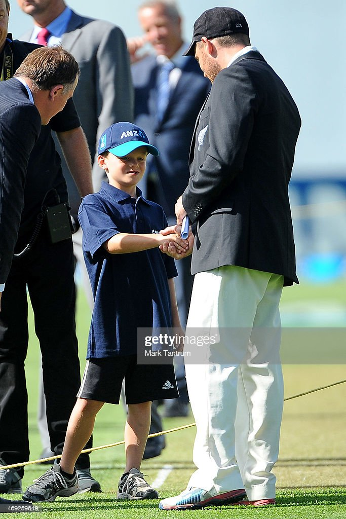 Matthew Crawford, 7, talks with Prime Minister <a gi-track='captionPersonalityLinkClicked' href=/galleries/search?phrase=John+Key&family=editorial&specificpeople=2246670 ng-click='$event.stopPropagation()'>John Key</a> (L) and <a gi-track='captionPersonalityLinkClicked' href=/galleries/search?phrase=Brendon+McCullum&family=editorial&specificpeople=208154 ng-click='$event.stopPropagation()'>Brendon McCullum</a> on the pitch prior to the start of the test match on February 14, 2014 in Wellington, New Zealand.