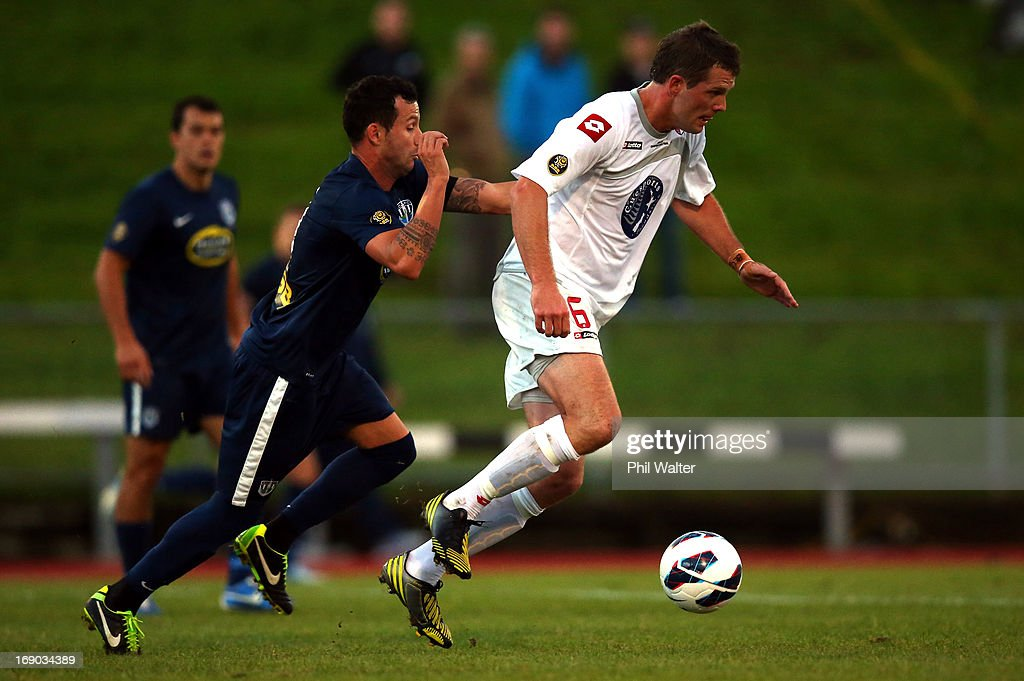 Matthew Cunneen of Waitakere takes the ball past Manel Exposito of Auckland during the OFC Champions League Final match between Auckland and Waitakere at Mt Smart Stadium on May 19, 2013 in Auckland, New Zealand.