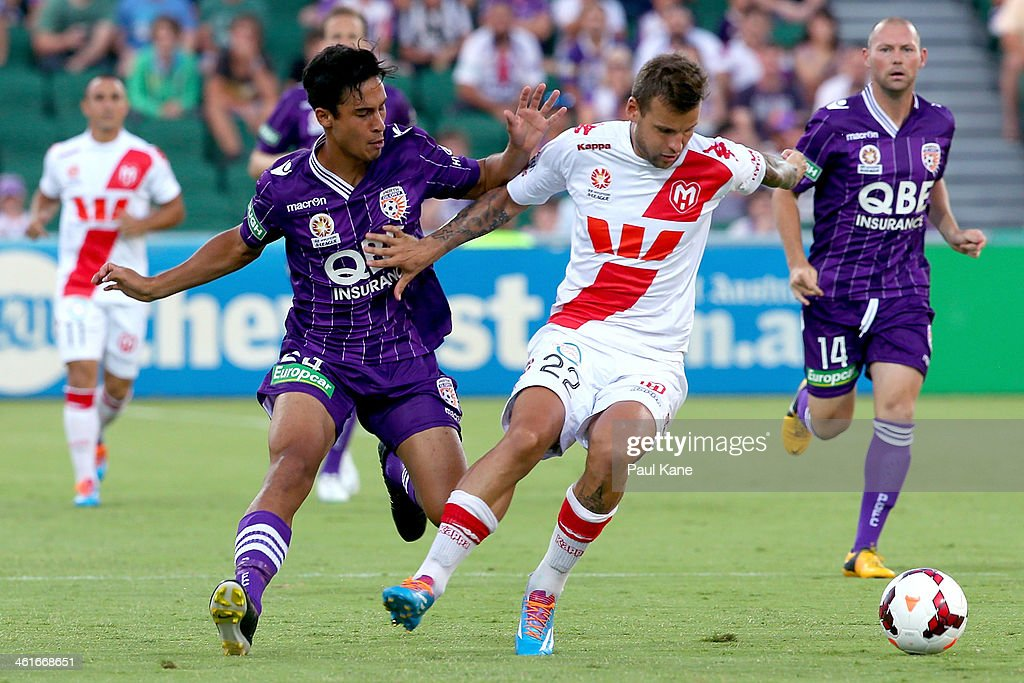 Matthew Davies of the Glory and Nicholas Kalmar of the Heart contest for the ball during the round 14 A-League match between Perth Glory and the Melbourne Heart at nib Stadium on January 10, 2014 in Perth, Australia.