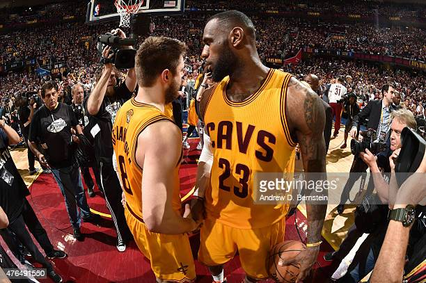 Matthew Dellavedova and LeBron James of the Cleveland Cavaliers celebrate after a victory over the Golden State Warriors in Game Three of the 2015...