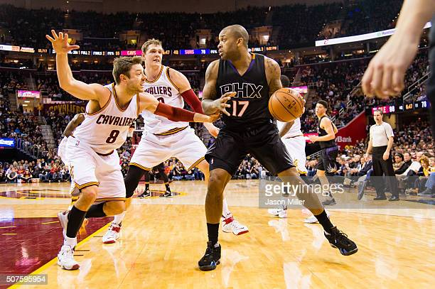 Matthew Dellavedova and Timofey Mozgov of the Cleveland Cavaliers guard PJ Tucker of the Phoenix Suns during the second half at Quicken Loans Arena...