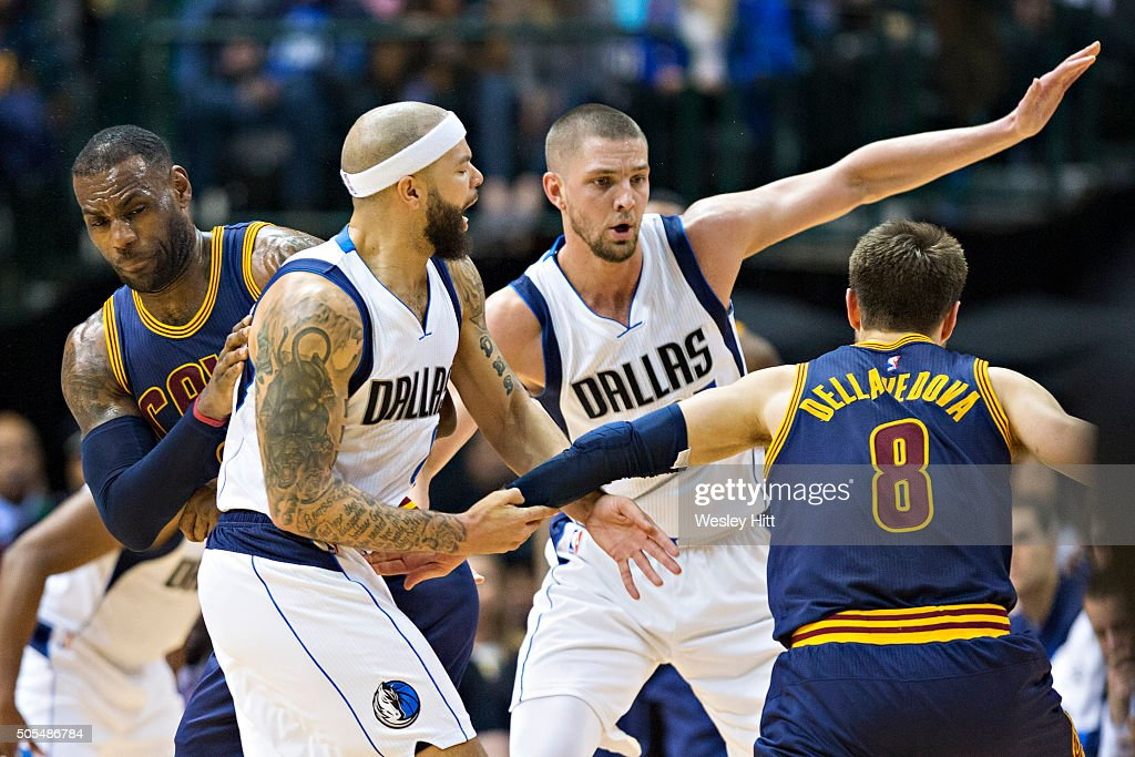 Matthew Dellavedova #8 drives around a pick set by LeBron James #23 of the Cleveland Cavaliers though Deron Williams #8 and Chandler Parsons #25 of the Dallas Mavericks at American Airlines Center on January 12, 2016 in Dallas, Texas.