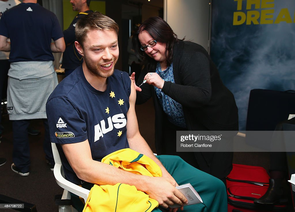 matthew dellavedova is given an injection for yellow fever during an australian boomers basketball team headshots - Yellow Hotel 2015