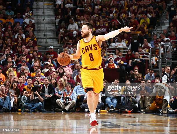 Matthew Dellavedova of the Cleveland Cavaliers calls out to his teammates during Game Three of the 2015 NBA Finals at The Quicken Loans Arena on June...
