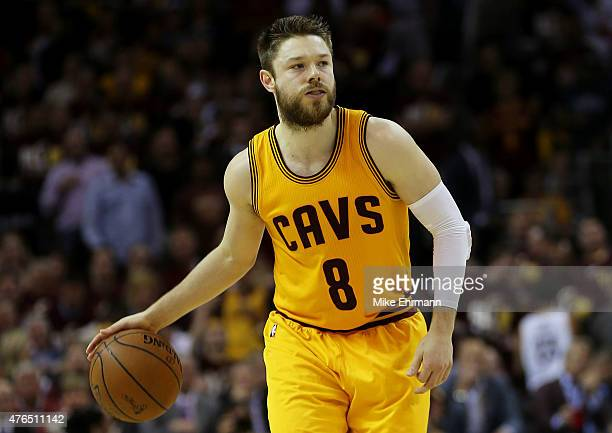 Matthew Dellavedova of the Cleveland Cavaliers controls the ball against the Golden State Warriors during Game Three of the 2015 NBA Finals at...