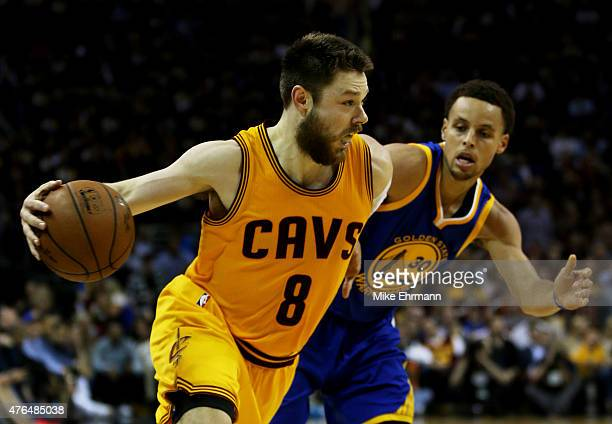 Matthew Dellavedova of the Cleveland Cavaliers drives against Stephen Curry of the Golden State Warriors in the third quarter during Game Three of...