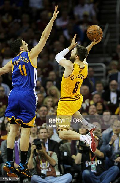Matthew Dellavedova of the Cleveland Cavaliers goes up against Klay Thompson of the Golden State Warriors in the first quarter during Game Three of...