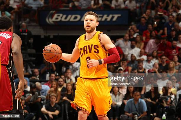 Matthew Dellavedova of the Cleveland Cavaliers handles the ball against the Miami Heat on March 19 2016 at AmericanAirlines Arena in Miami Florida...