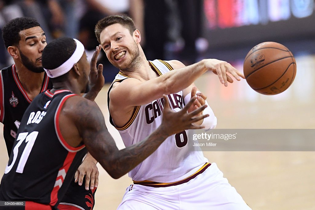 <a gi-track='captionPersonalityLinkClicked' href=/galleries/search?phrase=Matthew+Dellavedova&family=editorial&specificpeople=5948739 ng-click='$event.stopPropagation()'>Matthew Dellavedova</a> #8 of the Cleveland Cavaliers passes in the second quarter against <a gi-track='captionPersonalityLinkClicked' href=/galleries/search?phrase=Terrence+Ross&family=editorial&specificpeople=6781663 ng-click='$event.stopPropagation()'>Terrence Ross</a> #31 of the Toronto Raptors in game five of the Eastern Conference Finals during the 2016 NBA Playoffs at Quicken Loans Arena on May 25, 2016 in Cleveland, Ohio.