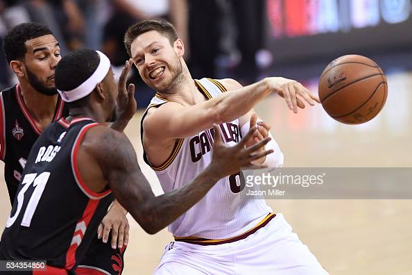 Matthew Dellavedova of the Cleveland Cavaliers passes in the second quarter against Terrence Ross of the Toronto Raptors in game five of the Eastern...