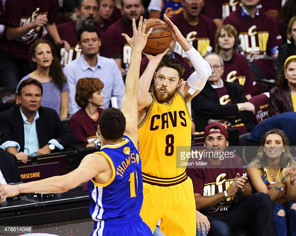 Matthew Dellavedova of the Cleveland Cavaliers shoots against Stephen Curry of the Golden State Warriors in the first quarter during Game Three of...