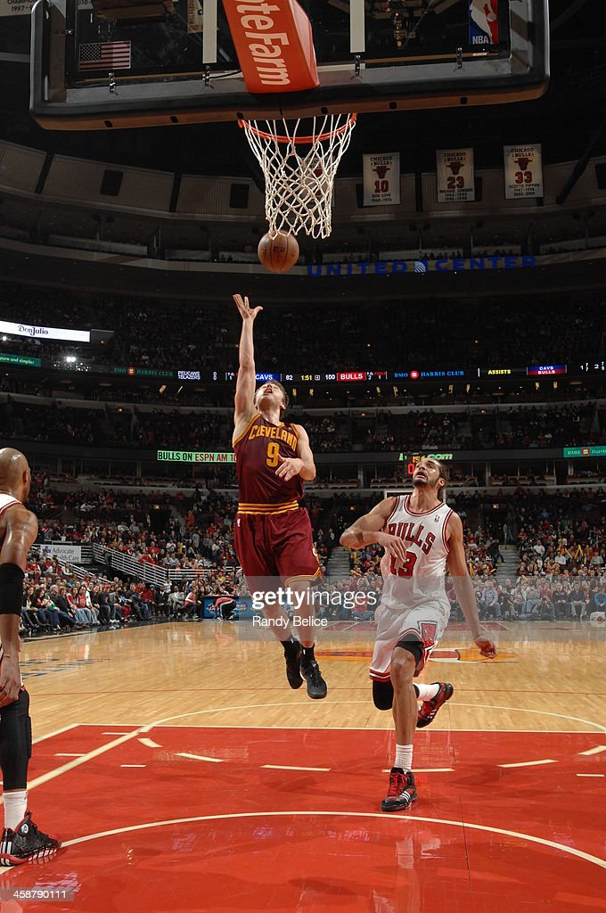 <a gi-track='captionPersonalityLinkClicked' href=/galleries/search?phrase=Matthew+Dellavedova&family=editorial&specificpeople=5948739 ng-click='$event.stopPropagation()'>Matthew Dellavedova</a> #9 of the Cleveland Cavaliers shoots against the Chicago Bulls on December 21, 2013 at the United Center in Chicago, Illinois.