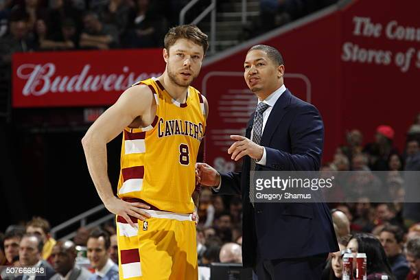 Matthew Dellavedova of the Cleveland Cavaliers talks with Head Coach Tyronn Lue of the Cleveland Cavaliers during the game against the San Antonio...