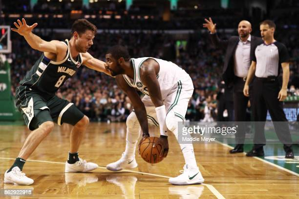 Matthew Dellavedova of the Milwaukee Bucks defends Kyrie Irving of the Boston Celtics during the fourth quarter at TD Garden on October 18 2017 in...