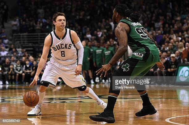 Matthew Dellavedova of the Milwaukee Bucks is defended by Jae Crowder of the Boston Celtics during a game at the BMO Harris Bradley Center on January...