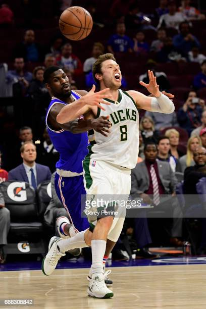 Matthew Dellavedova of the Milwaukee Bucks is fouled by Alex Poythress of the Philadelphia 76ers during the fourth quarter at the Wells Fargo Center...
