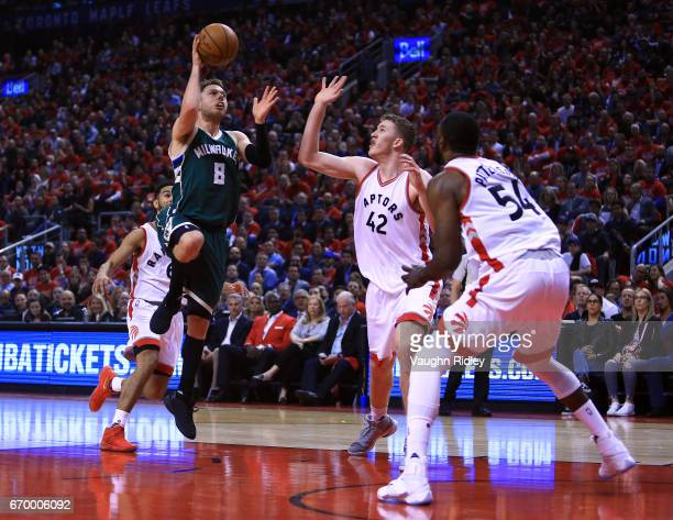 Matthew Dellavedova of the Milwaukee Bucks shoots the ball as Jakob Poeltl of the Toronto Raptors defends in the first half of Game Two of the...
