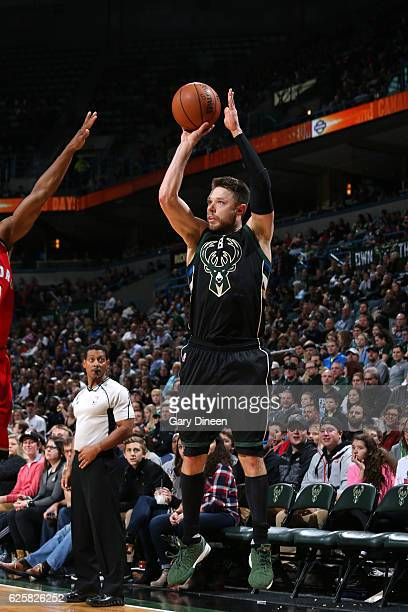 Matthew Dellavedova of the Milwaukee Bucks shoots the ball during the game against the Toronto Raptors on November 25 2016 at the BMO Harris Bradley...