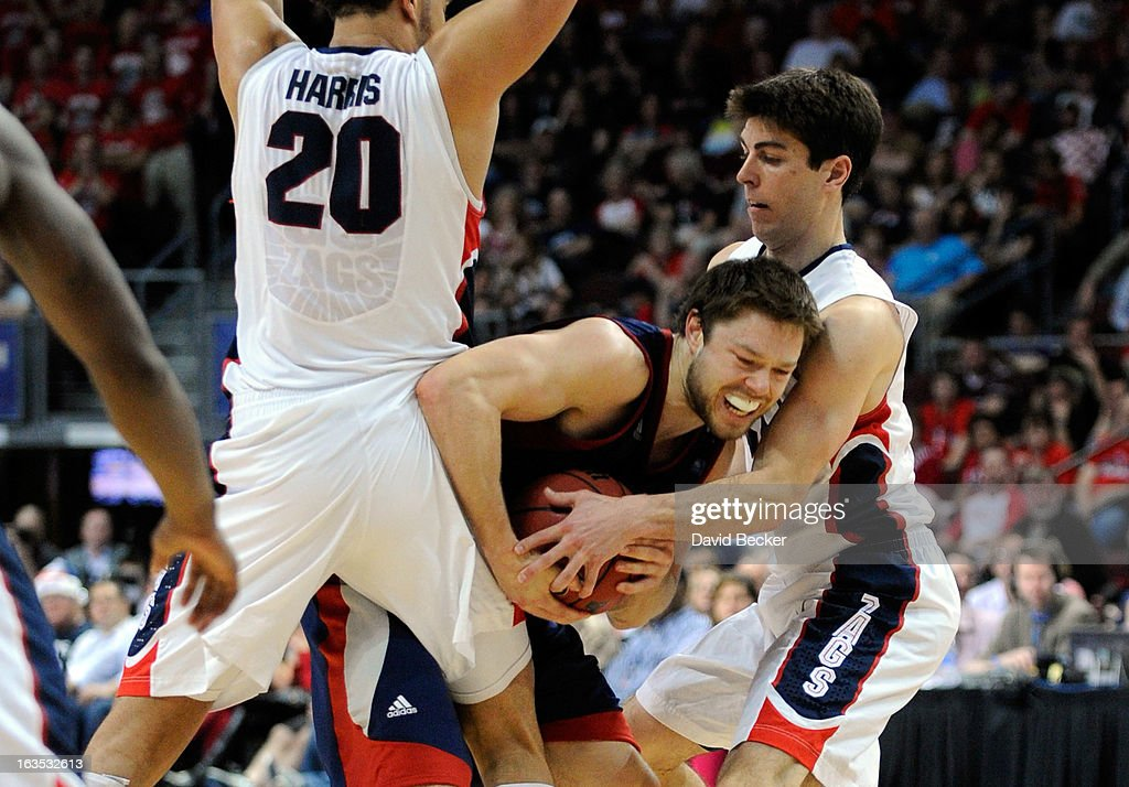 Matthew Dellavedova #4 of the Saint Mary's Gaels is double-teamed by <a gi-track='captionPersonalityLinkClicked' href=/galleries/search?phrase=Elias+Harris&family=editorial&specificpeople=6164446 ng-click='$event.stopPropagation()'>Elias Harris</a> #20 and <a gi-track='captionPersonalityLinkClicked' href=/galleries/search?phrase=Michael+Hart&family=editorial&specificpeople=171689 ng-click='$event.stopPropagation()'>Michael Hart</a> #30 of the Gonzaga Bulldogs during the championship game of the West Coast Conference Basketball tournament at the Orleans Arena March 11, 2013 in Las Vegas, Nevada. Gonzaga won 65-51.