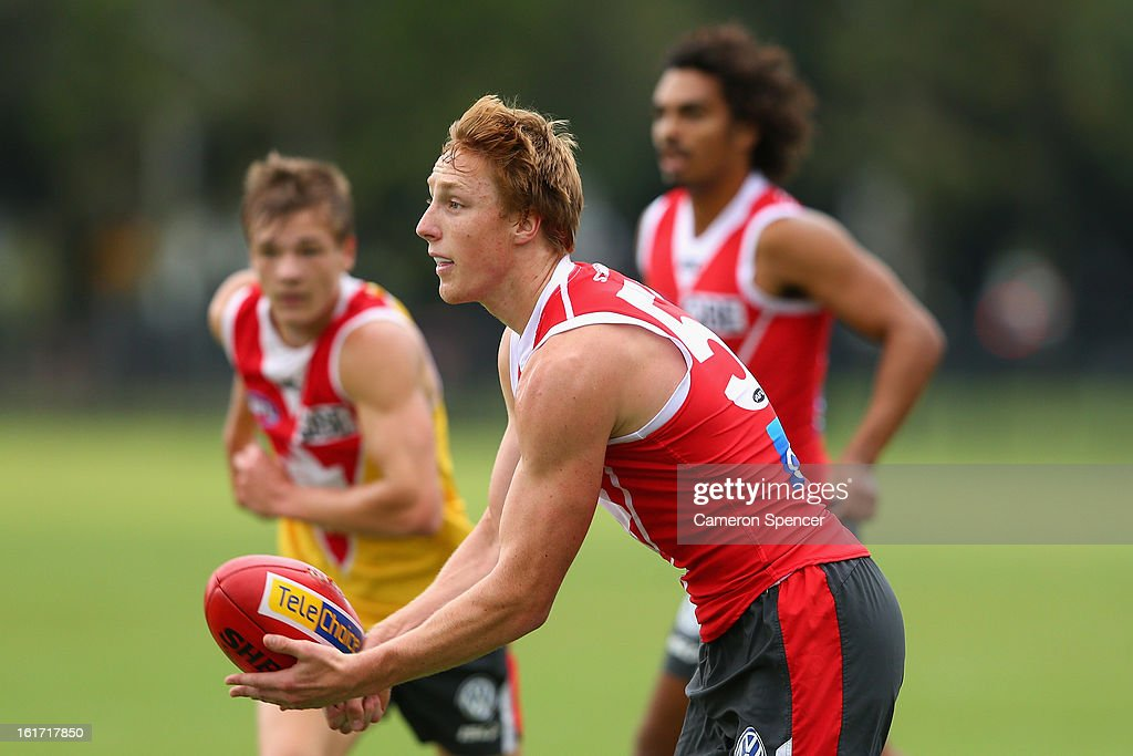 Matthew Dick of the Swans hand-passes during an intra-club practice match during a Sydney Swans AFL training session at Moore Park on February 15, 2013 in Sydney, Australia.