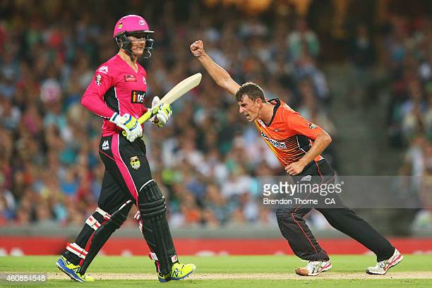 Matthew Dixon of the Scorchers celebrates after claiming the wicket of Nic Maddinson of the Sixers during the Big Bash League match between the...