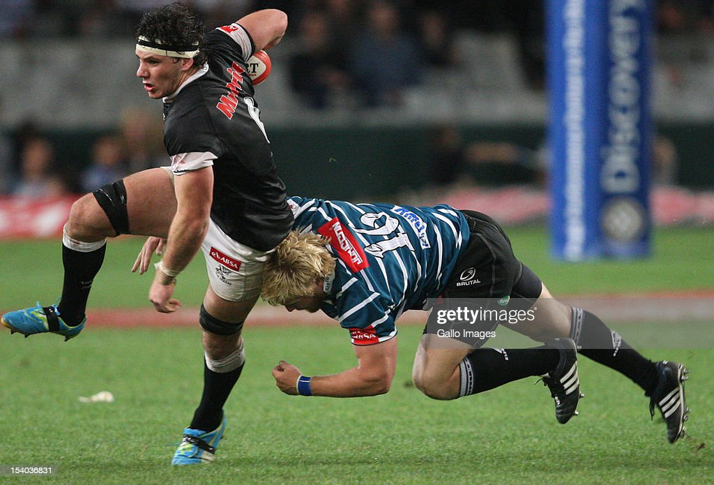 Matthew Dobson with a tackle on Marcell Coetzee during the Absa Currie Cup match between The Sharks and GWK Griquas at Mr Price KINGS PARK on October 12, 2012 in Durban, South Africa.