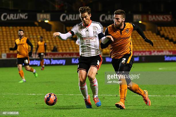 Matthew Doherty of Wolves and Scott Parker of Fulham battles for the ball during the FA Cup third round replay match between Wolverhampton Wanderers...