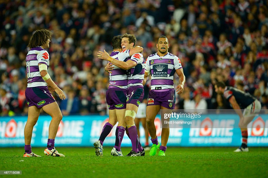 Matthew Duffie celebrates victory with Cooper Cronk of the Storm during the NRL qualifying final match between the Sydney Roosters and the Melbourne Storm at Allianz Stadium on September 11, 2015 in Sydney, Australia.