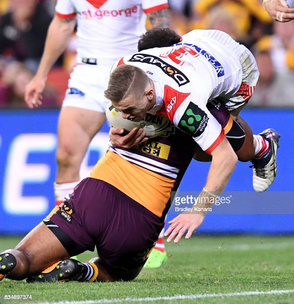 Matthew Dufty of the Dragons is tackled during the round 24 NRL match between the Brisbane Broncos and the St George Illawarra Dragons at Suncorp...