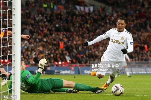 Matthew Duke of Bradford City fouls Jonathan de Guzman of Swansea City in the area for a penalty during the Capital One Cup Final match between...