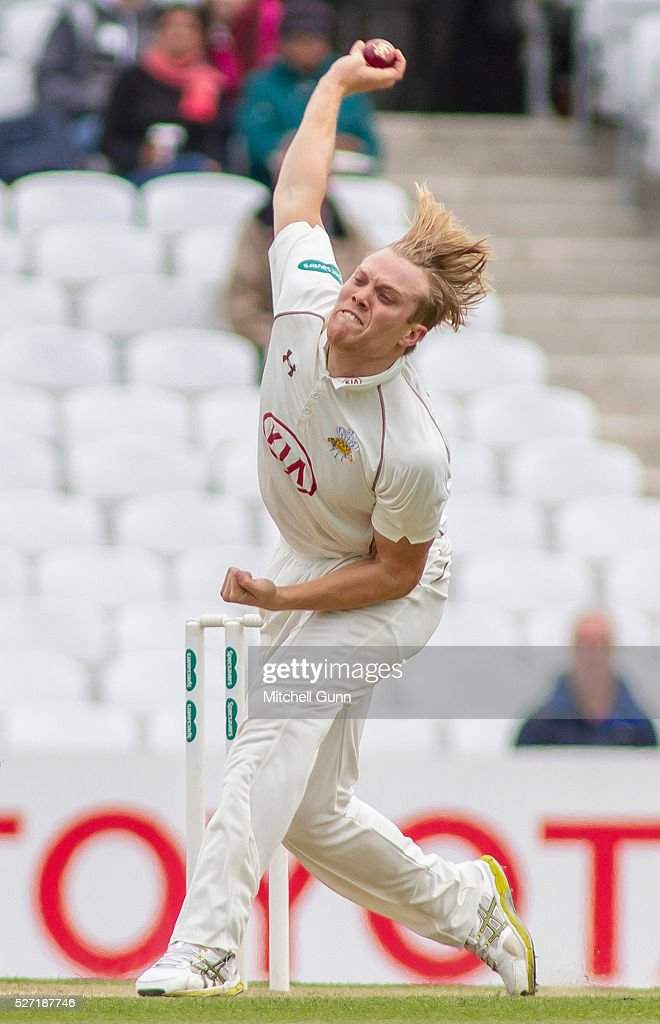 Matthew Dunn of Surrey bowling during the Specsavers County Championship Division One match between Surrey and Durham at the Kia Oval Cricket Ground, on May 02, 2016 in London, England.