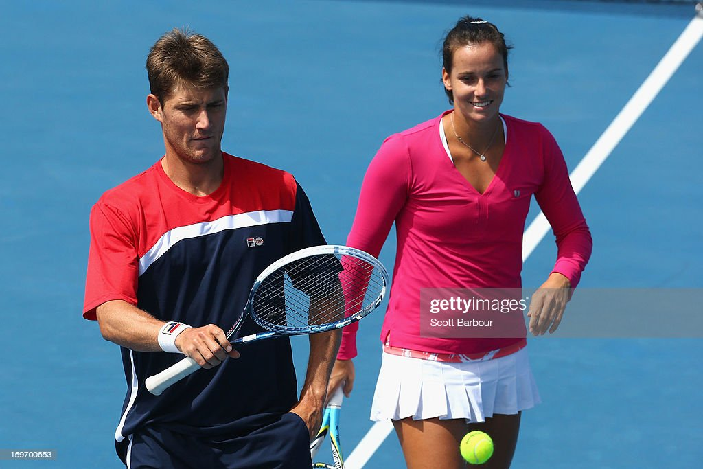 Matthew Ebden and Jarmila Gajdosova of Australia talk tactics in their first round mixed doubles match against Sabine Lisicki of Germany and Frederik Nielsen of Denmark during day six of the 2013 Australian Open at Melbourne Park on January 19, 2013 in Melbourne, Australia.