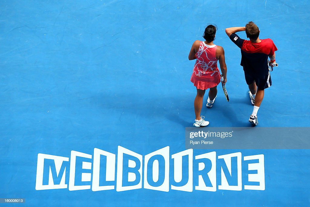 Matthew Ebden of Australia and Jarmila Gajdosova of Australia look on their mixed doubles Semifinal match against Denis Istomin of Uzbekistan and Yaroslava Shvedova of Kazakhstan during day twelve of the 2013 Australian Open at Melbourne Park on January 25, 2013 in Melbourne, Australia.