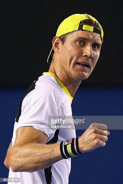 Matthew Ebden of Australia celebrates winning a point in his second round singles match against Vasek Pospisil of Canada during day three of the 2014...