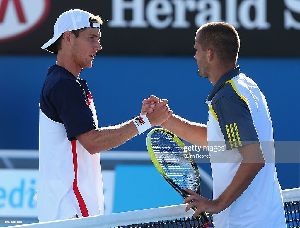 Matthew Ebden of Australia congratulates Mikhail Youzhny of Russia after his first round match win during day one of the 2013 Australian Open at Melbourne Park on January 14, 2013 in Melbourne, Australia.