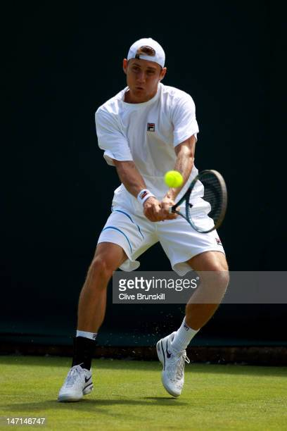 Matthew Ebden of Australia hits a backhand return during his Gentlemen's Singles first round match against Benoit Paire of France on day two of the...