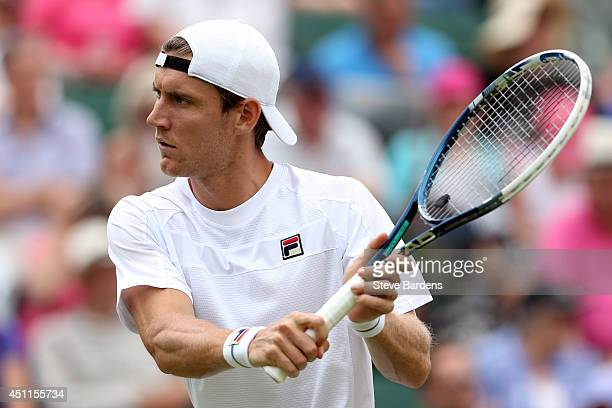 Matthew Ebden of Australia in action during his Gentlemen's Singles first round match against Milos Raonic of Canada on day two of the Wimbledon Lawn...