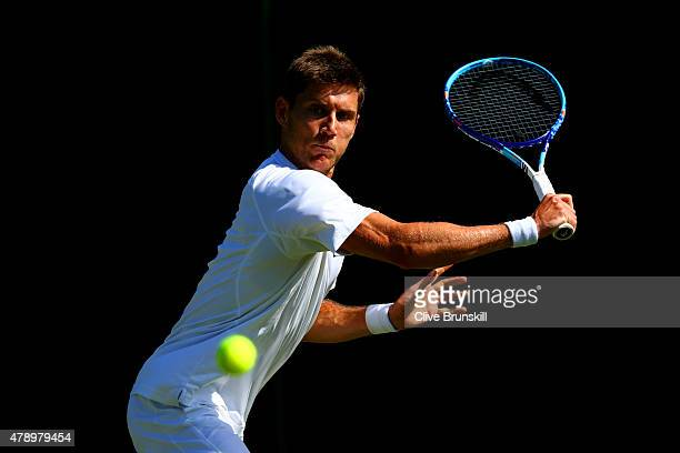 Matthew Ebden of Australia in action in his Gentlemen's Singles first round match against Blaz Rola of Slovenia during day one of the Wimbledon Lawn...