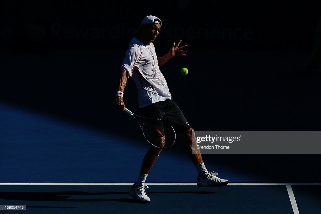 Matthew Ebden of Australia plays a backhand in his first round match against Marcel Granollers of Spain during day two of the Sydney International at Sydney Olympic Park Tennis Centre on January 7, 2013 in Sydney, Australia.