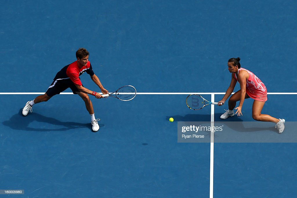 Matthew Ebden of Australia plays a backhand in his mixed doubles Semifinal match with Jarmila Gajdosova of Australia against Denis Istomin of Uzbekistan and Yaroslava Shvedova of Kazakhstan during day twelve of the 2013 Australian Open at Melbourne Park on January 25, 2013 in Melbourne, Australia.