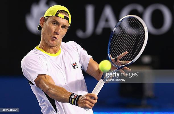 Matthew Ebden of Australia plays a backhand in his second round singles match against Vasek Pospisil of Canada during day three of the 2014...