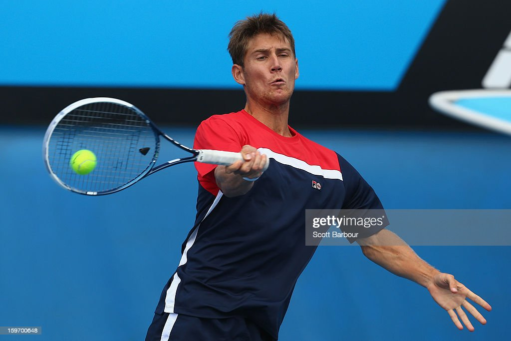 Matthew Ebden of Australia plays a forehand in his first round mixed doubles match with Jarmila Gajdosova of Australia against Sabine Lisicki of Germany and Frederik Nielsen of Denmark during day six of the 2013 Australian Open at Melbourne Park on January 19, 2013 in Melbourne, Australia.
