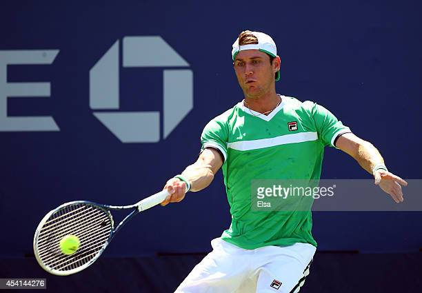 Matthew Ebden of Australia returns a shot during his men's singles first round match against Tobias Kamke of Germany on Day One of the 2014 US Open...