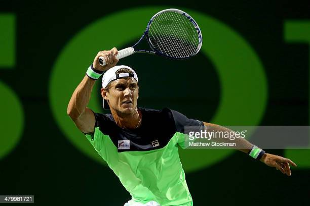 Matthew Ebden of Australia returns a shot to Andy Murray of Great Britain during the Sony Open at the Crandon Park Tennis Center on March 21 2014 in...