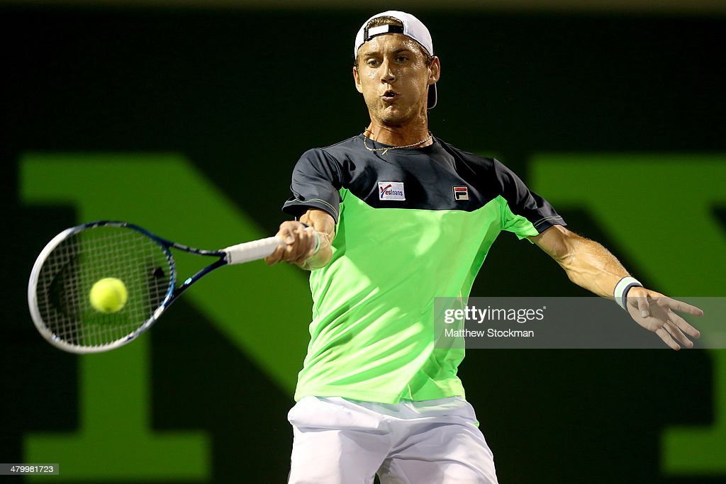 Matthew Ebden of Australia returns a shot to Andy Murray of Great Britain during the Sony Open at the Crandon Park Tennis Center on March 21, 2014 in Key Biscayne, Florida.