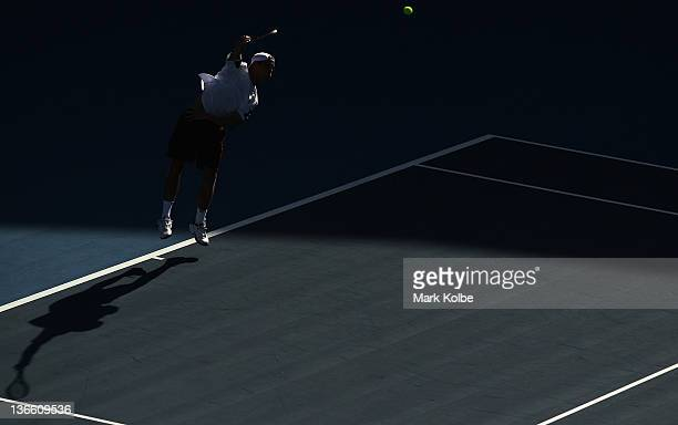 Matthew Ebden of Australia serves in his first round match against Marcel Granollers of Spain during day two of the 2012 Sydney International at...
