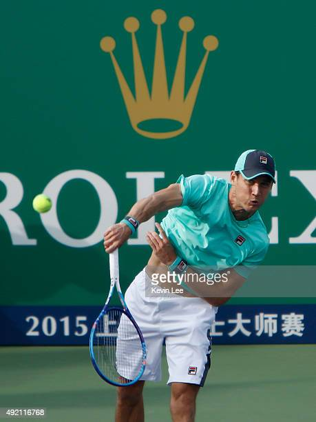 Matthew Ebden of Australia serves to Nicolas Mahut of France during a match at the preview of Shanghai Rolex Mastes 2015 at Qi Zhong Tennis Centre on...